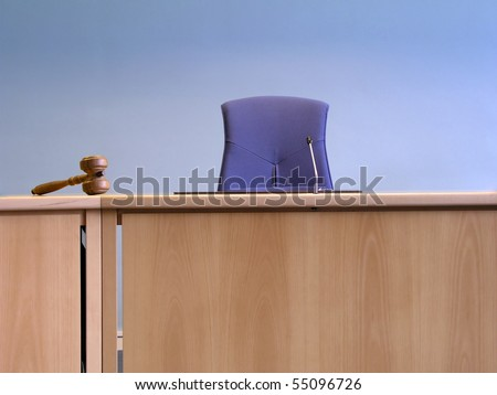 Court's room with tables,chair and hammer