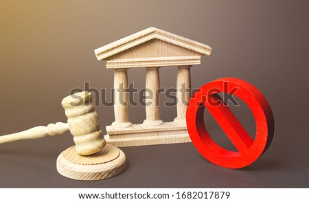 Courthouse and red prohibition sign NO. Implementation of laws restrictions and prohibition. Fines and penalties for rules violations. Unpopular laws, restriction of rights and freedoms. Lack justice