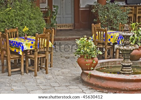 Courtyard mexican restaurant with a fountain and colorful tables
