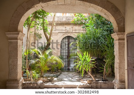 Courtyard of an old baroque palace and plants in the old Syracuse