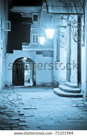 Courtyard of historical buildings in Lviv at night