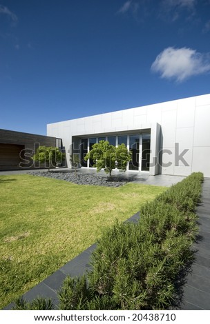 Courtyard of modern building with grass and trees