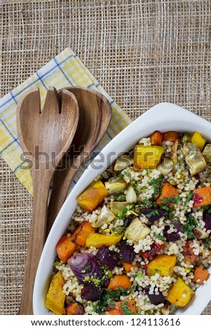 Couscous and roasted vegetables salad in a white dish