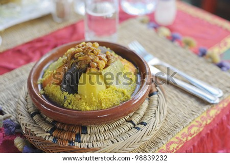 Couscous served on a brown plate in a Marrakesh restaurant