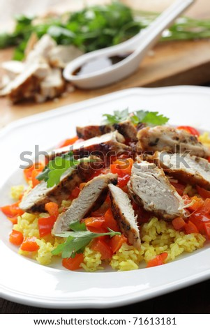 Couscous with grilled chicken breast, roasted pepper, and parsley