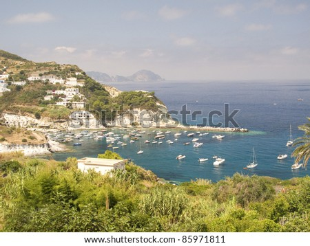 Cove and Coastline with sailboats and clear water (Ponza, Italy)