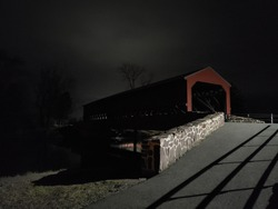 Covered bridge at night, specifically Sachs Bridge in Gettysburg Pennsylvania.