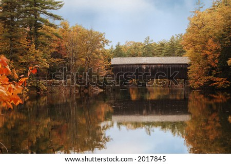 covered bridge in Maine during fall colors