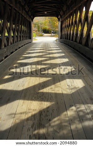 covered bridge in new england in autumn
