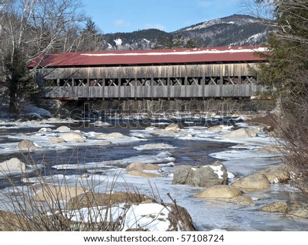 covered bridge in winter on the kancamangus highway in the white mountains in new hampshire