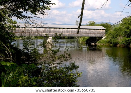 Covered bridge over the Connecticut River - stock photo