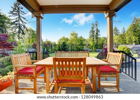 Covered outdoor Terrace with dining room and beautiful back yard.