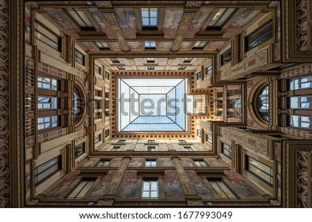 Covered passage of Galleria Sciarra building, decorated in Liberty Stile with allegoric paintings, in Trevi district of Rome, Italy
