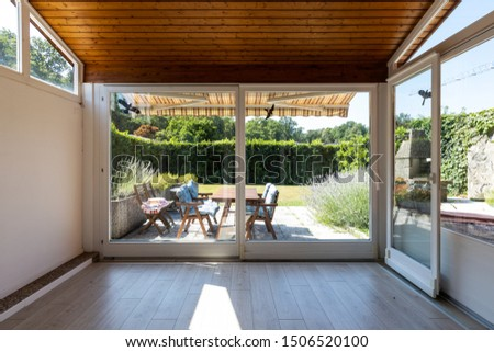 Covered veranda with access to the private garden. Nobody inside