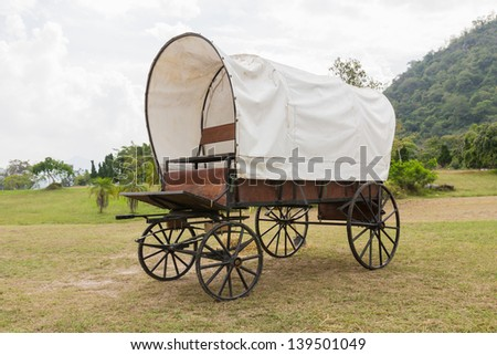 Covered wagon with white top in park