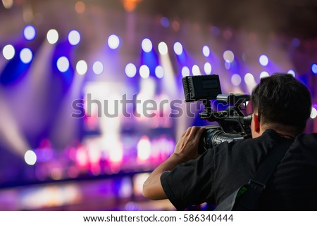 Covering an event on stage with a video camera. Сток-фото ©