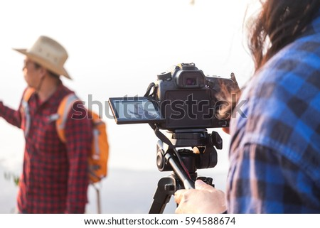 Shutterstock Covering an event with a video camera