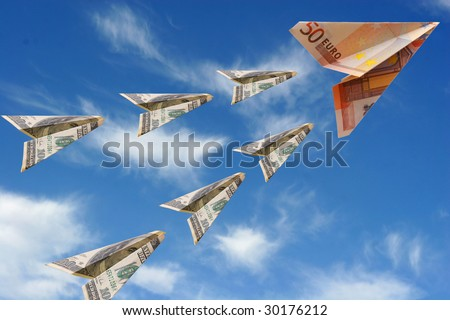 covey of dollars flies after euro - stock photo