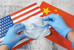 covid - 19, coronavirus concept. China helps USA fight coronavirus, USA and China flags and medical mask, coronavirus epidemic in United States of America concept