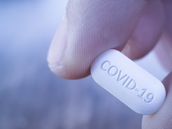 COVID 19 Coronavirus Cure drug concept in one tablet. Concept for antiviral drug for new korona virus. Medication pharmaceutical for Corona treatment. Close up concept for Covid Cure