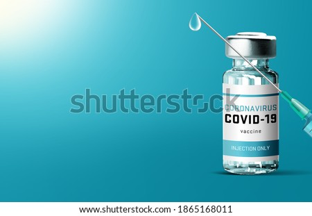 Covid-19 coronavirus vaccine concept - one glass vials with metal caps on blue table with medical supplies in background. Vaccination against 2019-nCoV virus. Victory epidemic SARS-nCoV space for text