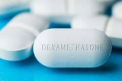 COVID-19 corticosteroid medication drug DEXAMETHASONE,pile of white pills with letters engraved on side,potential experimental WHO Coronavirus cure,pandemic outbreak crisis,US antiviral clinical trial