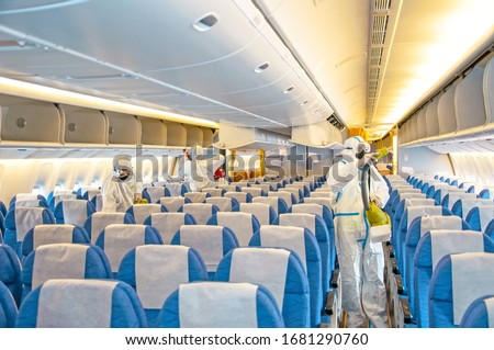 Covid-19 disease virus prevention. Airlines interior cabin deep cleaning for coronavirus. Сток-фото ©