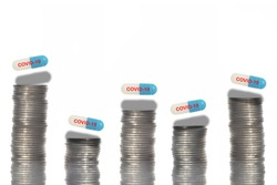 Covid-19 drug capsule on coins layout and stack in w-shaped recession on white background