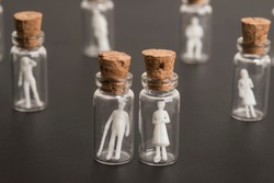 Covid-19 epidemic, protection of older and more vulnerable people, concept. Elderly couple figures inside a glass bottle