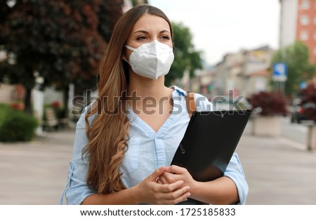 COVID-19 Global Economic Crisis Unemployed Worried Girl with Mask Looking for a Job Walking in City Street Delivering Curriculum Vitae