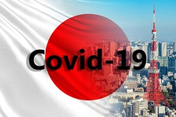 Covid 19 in Japan. Japanese flag with the inscription Covid. Named coronavirus on the background of Tokyo. Concept - the danger of travel to Japan. Concept - flash China Epidemics in Tokyo