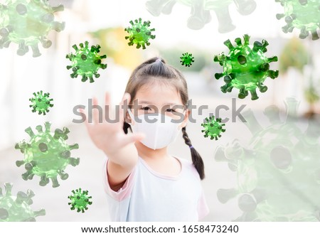 Covid-19 Kawasaki disease in children.Little asian chinese girl wearing mask for Virus show stop hands gesture for stop coronavirus outbreak.Covid19 coronavirus, New normal, Reopen school, Healthcare.