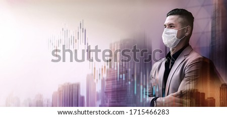 Covid-19 or Corona Virus Situation in Business. Businessman with Surgical Mask Looking away. Financial or Economy Crisis Concept. Stock Marketing Graph is going Crash and Down