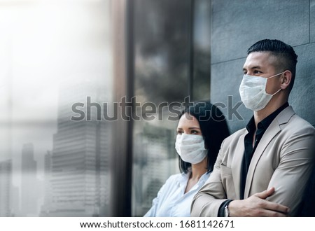 Covid-19 or Corona Virus Situation in Business Concept. Business People with Surgical Safety Mask standing at Office Urban Building. Team Employees or Owner Protected and take Care of their Health