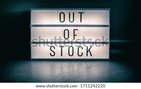 Covid-19 OUT OF STOCK store lightbox sign showing text message for shortage of PPE medical supplies. Coronavirus panic hoarding led to sold out shelves. shortage of hand sanitizer, mask products. Stockfoto ©