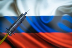 COVID-19 Pandemic Coronavirus concept. Russia Coronavirus vaccine, Sputnik V. Covid-19 vaccination, flu prevention, immunization concept with Russian Flag at background. Spoutnik V new russia vaccine.