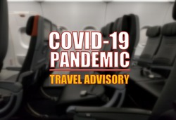 Covid-19 pandemic travel advisory on a blurry background