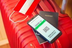 Covid 19 passport, Green pass Austria immunity passport, traveling  bag and passport