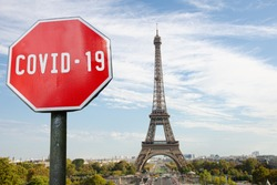 COVID-19 sign with Eiffel tower in Paris, France. Warning about pandemic in France. Coronavirus disease. COVID-2019 alert sign