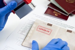 COVID-19 stamped passport ID,airport border customs health and safety security check,restrictive no entry measures due to SARS-CoV-2 corona virus disease epidemic,Coronavirus global pandemic,US  UK