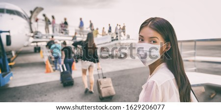 COVID-19 Travel Airport Asian woman tourist boarding plane for holiday wearing face mask. PPE Corona virus Coronavirus negative test and vaccine passport banner panoramic.