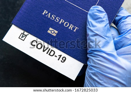 COVID-19, travel and lockdown concept, COVID mark in tourist passport. Medical test in airport due to coronavirus spread. Business and tourism hit by corona virus, restrictions during pandemic.