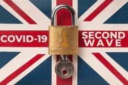 Covid-19 UK lockdown concept: a lock over a union jack flag with the message