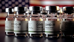 Covid Vaccine Bottles with American Flag in the Background Corona Vaccine Bottles in front of a USA Flag Covid Vaccine - Photo of COVID-19 Vaccines phials prepared for use in Covid-19 pandemic Ampule