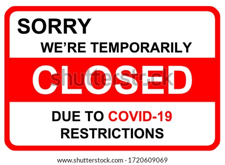 COVID-19 Warning sign,`Sorry, we`re closed due to COVID-19' restrictions Warning sign in public places. Restriction and caution Coronavirus. ストックフォト ©