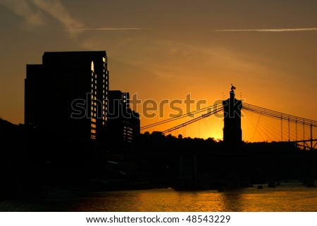 Covington Kentucky At Sundown, Across The Roebling From Cincinnati, The John A. Roebling Suspension Bridge In Silhouette