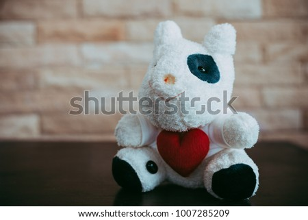Cow doll holding a red heart shape, Valentine 's Day concept. #1007285209