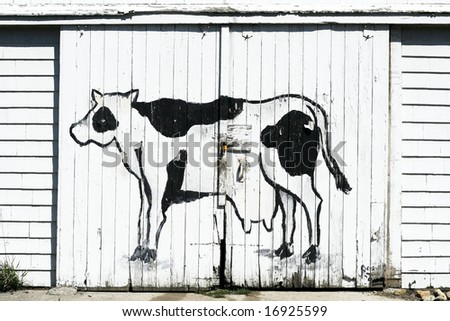 cow painted on side of barn doors