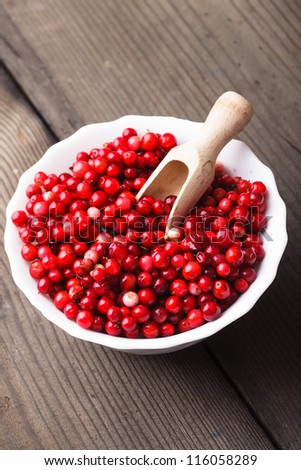 Cowberry in the bowl on the table
