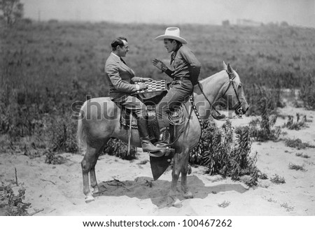 cowboy and businessman playing...